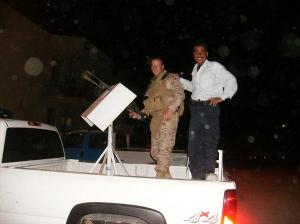 Joe with an Iraqi policeman